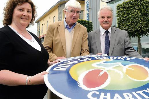 Catherine Coffey and George McSweeney, Chairman Killarney Credit Union, presenting sponsorship for the Ring of Kerry Charity Cycle to (centre) the Ring of Kerry Charity Cycle Chairman Tim O'Brien at Killarney Credit Union on Tuesday. Photo by Michelle Cooper Galvin