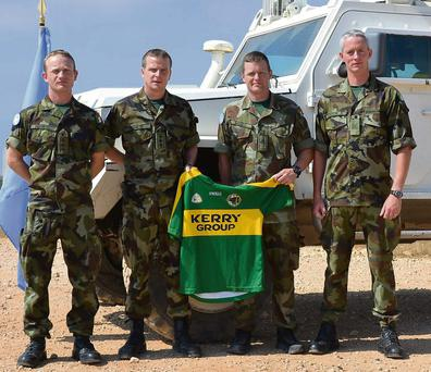 Captain John Murphy, Captain Declan Barrett, Private Dermot Meehan and Sergeant Christopher Hoare are on duty in the Lebanon, but they have Kerry football on their minds at the moment.