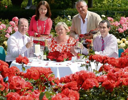 Past and present Rose of Tralee International Festival organisers came together among the radiant roses in Tralee Town Park to announce details of this year's Gala Rose Ball in the Dome on Friday 16th August. Serving up a treat were former Festival President Con O'Connor (left), former Festival Chairperson June Carey (centre) were joined by the current General Manager Oliver Hurley, Assistant General Manager Valerie Kerins and Festival Team Volunteer John O'Donnell.