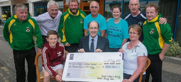 James Rusk and Elma Walsh present a cheque for €9000.84 to Gerry Cully, Fundraiser Manager of Crumlin Children's Hospital, the proceeds of Tralee Boxing club tournament in The Brandon Hotel in May inspired by the late Donal Walsh. Pictured also are Pat O'Shea, Fionnbar Walsh, Seamus O'Mahony, Noel Kelliher, Lisa Carolan, Tommy Kelliher and Con O'Shea. The club wishes to thank The Brandon Hotel and the people of Tralee for supporting the event.