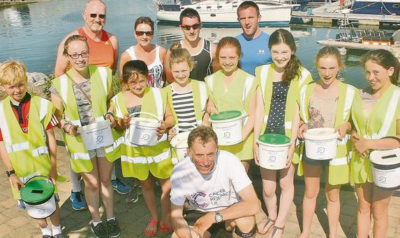 Alan Rankin with members of Dingle Sailing Club and West Kerry Fitness before his 10km run around Dingle, part of his ten port voyage around Ireland anmd the UK. Photo by Marian O'Flaherty