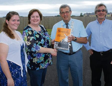 Mayor of Tralee Cllr Pat Hussey presents Meghan O'Reilly Fiero with a copy of the book. Left, Becky Fiero (left), great-granddaughter of Nicholas.
