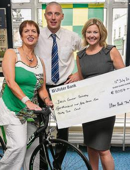 Mary Glazier with Kieran Donaghy and Patrisha Kelly, winner of the Ulster Bank, Tralee raffle in aid of the Irish Cancer Society