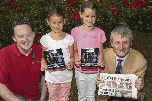 Maria and Ana Draghici from Killeen Heights, Tralee, winners of the Kerryman JLS - Meet and Greet Competition with Bryan Carr (left), Rose of Tralee, Street Festival Manager and Bernard O'Keeffe of The Kerryman newspaper. Photo: Paul Tearle