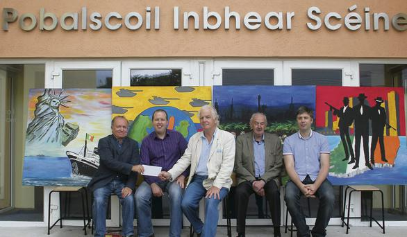 Terry O'Doherty presents Joe Thoma, art teacher at Pobalscoil Inbhear Scéine, with a cheque from Mr Patrick O'Toole of PLM Architects, Kenmare and Cork who generously sponsorsored the art exhibition. Pictured here with four of the 12 paintings for the exhibition, which will be launched in the Carnegie Arts Centre on Friday, August 30 are, from left: Joe Thoma, Jerry O'Sullivan, chairman of Kenmare Gangs of New York Festival; Terry O'Doherty, Michael Connor Scarteen and John O'Sullivan. Photo: Mary O'Neill