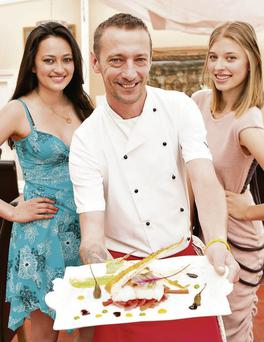 At the official launch of the forthcoming Food and Fashion night in Allo's Bar and Bistro on Wednesday, August 21 were Listowel models Eileen Sweeney and Ola Michniewicz with Allo's Chef Theo Lynch.