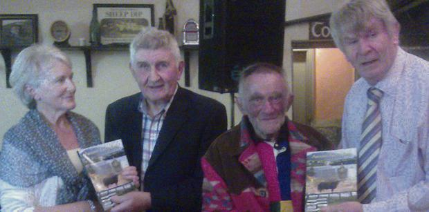 At the launch of Pat Lynch's book 'Around Kells Bay' the first two books were presented to Molly King (99 years young, the most senior lady in the neighbourhood) and Mick Murphy, (the Iron Man, winner of the Rás Tailteann in 1958). Eileen Reardon accepted the first book on behalf of Molly King from special guest Mick O'Dwyer and the second book was presented to Mick by the author Pat Lynch.