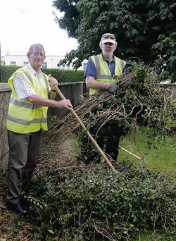 Corry Flaherty and Pádraig O'Sullivan doing an Operation Transformation job on the grounds of Cheshire Home, Killarney, recently.