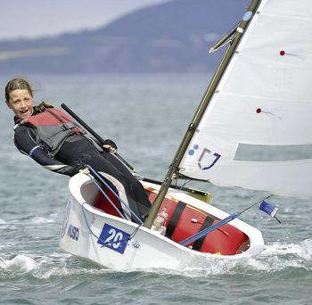 Ellie Cunnane from Dingle Bay Sailing Club competing in the Regatta fleet of the Jelly Bean Factory Irish National Optimist Championship in the National Yacht Club. Photo: Michael Chester/Chester.ie