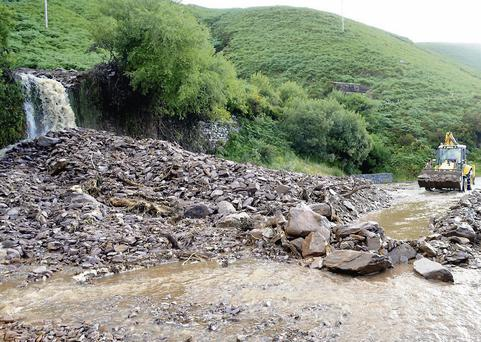 Work in progress clearing the landslide at Mountain Stage, Glenbeigh, back