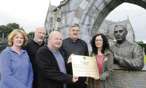 Canon Michael Fleming with Killorglin Parish Pastoral Council members Gretta O'Sullivan, Bill Browne, Terence Houlihan and Sinead Geary next to the plaque which will be unveiled on Saturday next, September 14, to honour Fr Tom Lawlor and mark the 125th anniversary of St James' Church, Killorglin. Photo by Michelle Cooper Galvin