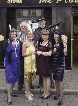 Steve Smith of the Ploughman Bar (back left) is joined by Craig Smith, Margueritte Williams, Marie and Shannon Smith and Kathleen McCoy in full costume ahead of Friday night's Roaring 20s event in the bar.