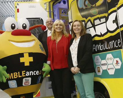 Tony and Mary Heffernan, of The Saoirse Foundation, and Miriam O'Callaghan launching the world's first interactive Children's Ambulance Service. The BUMBLEance was created and developed by Tony and will be operated by LifeLine. The service will commence its pre-booked journeys with sick children on the September 16. Photo by Conor Healy Photography