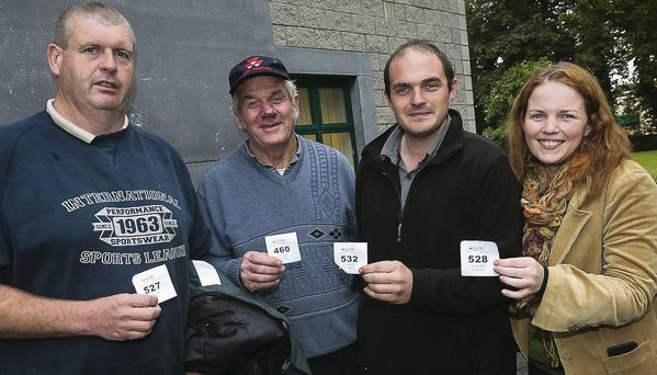 Long delays at the Motor Tax office on the last day of the month- Liam O'Connor, Nicolas King, Mike Ahern and Emily Ahern from Cromane with their queue tickets with over 200 in front
