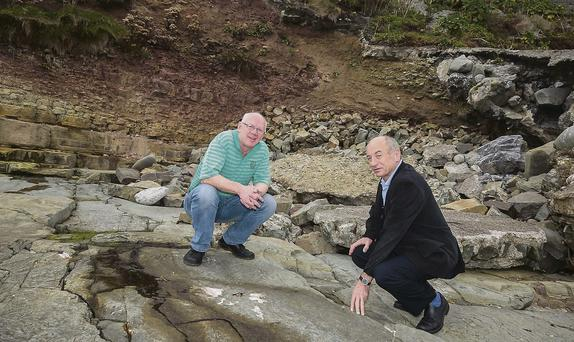 Cllr John Brassil and John P. Leen examine the erosion in Ballyheigue.