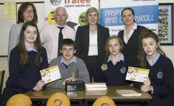 At the launch of the joint schools' Tralee Credit Union branch launch at St Joseph's Presentation Secondary School on Thursday morning were, front: Michelle O'Connor, Shane McGaley, Ciara Murphy, branch manager and Laura Geaney. Back, from left: Mary O'Connell, Tralee Credit Union; Fintan Ryan, Tralee Credit Union manager; Eileen Kennelly, principal St Joseph's and Orla O'Shea, youth development worker, Tralee Credit Union.