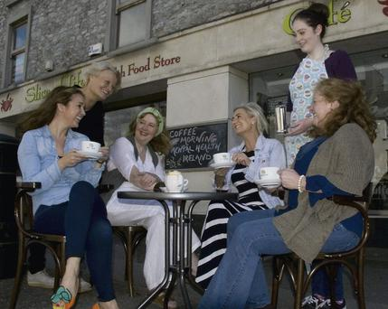 Slice of Life proprietor, Monica O'Connor (seated, centre left) with, from left: Tina Brennan, Kate Walsh, Noreen Cronin, Jessica Murphy and Bridie Garvey as they flagged their forthcoming Coffee Morning for Mental Health Ireland on Saturday.