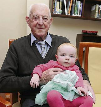 Michael Dowling celebrating his 100th birthday with his great-granddaugher Ciara Coleman who was celebrating her 1st birthday. Photo: Michelle Cooper Galvin.