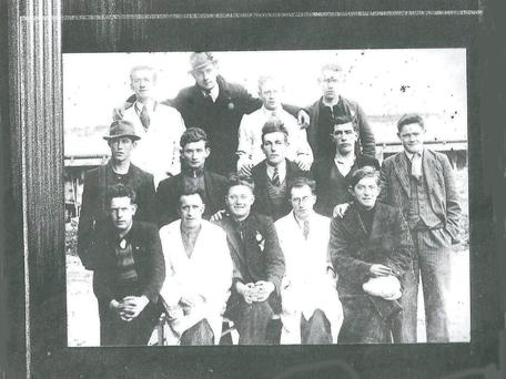 The Kildare turf cutters. (back, from left) John Gaffney O'Sullivan, Michael 'The Roddy' Murphy. (middle) Mick Cahill, Maurice O'Connell, John Dennehy, John O'Driscoll , Mikey Joe Burton. (front) Joe O'Shea, Danny McCarthy, Georgie O'Shea. Those in the white coats are unknown.