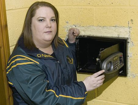 Moyvane GAA Club PRO Áine Cronin with the safe that held the club's defibrillator.