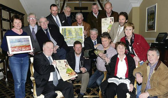 Launching the Killarney Rotary Wine and Art night were Paul Sherry, President, Killarney Rotary, Tom Leslie, Conor Hennigan, Geert Maes Killarney Rotary, Breda Dwyer Irish Wheelchair Association, Barry Murphy (standing from left) Katie O'Connell, Brendan Coffey Irish Pilgrimage Trust, Con Brosnan Irish Kidney Association, Rory Darcy St Oliver's National School Ballycasheen and Killarney Rotary, Eduard Schmidt-Zorner, James Tarrant, Con Keane, Conor Griffin, John O'Sullivan Killarney Rotary and Jean Courtney South-East Kerry Rural Recreational Micro Track at The Malton, Killarney.