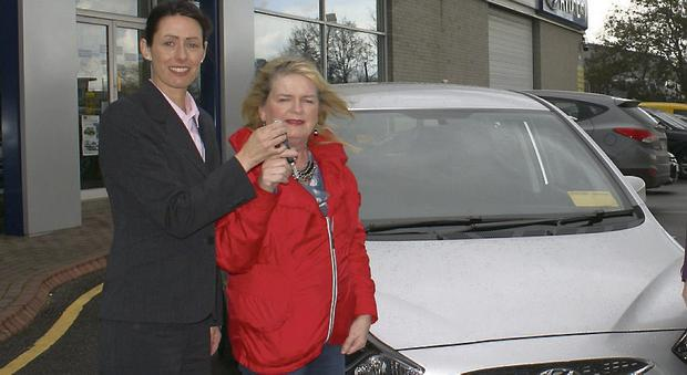 Margaret Goodall collects the keys of her new car from Tralee Credit Union Assistant Manager Katrina Rice.