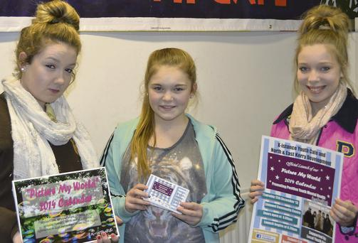 Adi Canty, Caoimhe Shine and Alannah Curtain of Xistance Youth Café showing off their 2014 calendar.