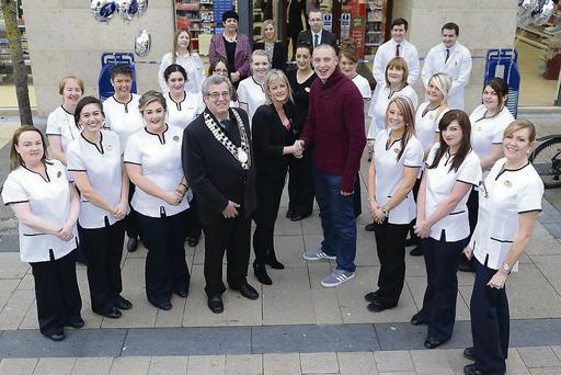 Kieran Donaghy cuts the ribbon, along with Boots manager Aine Moriarity, Mayor of Tralee Cllr Pat Hussey and Boots staff.