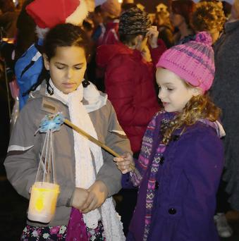 Naomi Antar (Minard) and Aisha Scharer (Dingle) enjoying the Children's Lanterns Parade during Feile na Saoilse in Dingle on Sunday evening.