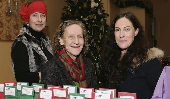 Deirdre Daly from Dingle (centre) with Judi Pheysey and Ita Elezi (Killarney Crafters) at the Kerry Christmas market at the Skellig Hotel in Dingle on Saturday afternoon.