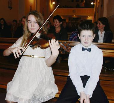Rachel Martin and Brian Creegan getting ready to perform at the Tarbert Christmas concert.