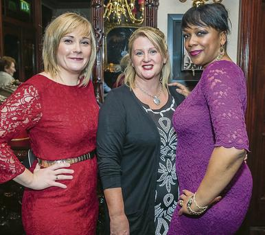 Lisa O'Carroll, Eileen Davis and Abbey Cummings enjoying the Kerry Local Authority Christmas social at the Grand Hotel on Saturday.
