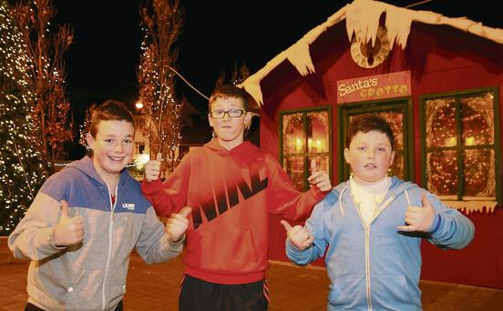 Local lads Tommy O'Connell, Aaron Lee and Joshua Enright giving Abbeyfeale's new Christmas look the sign of approval at the weekend.