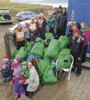 Voluntary litter-pickers pack up the rubbish collected at the Maharees over the weekend.
