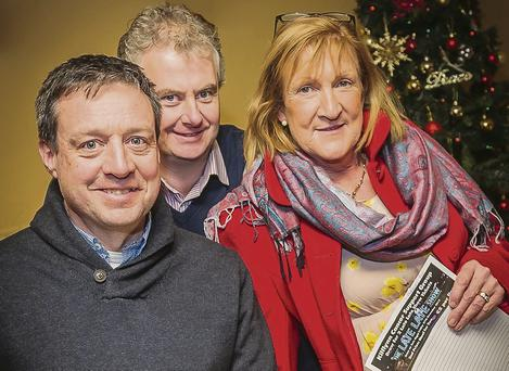 Quiz master John O'Flaherty studies questions for the 10th anniversary Kilflynn Cancer Support Group Table Quiz at Parker's Pub and Herbert's Bar, Kilflynn on Friday 27th December at 9pm. Pictured here with Mike Parker and Joan Herbert. (Photo by Paul Tearle)