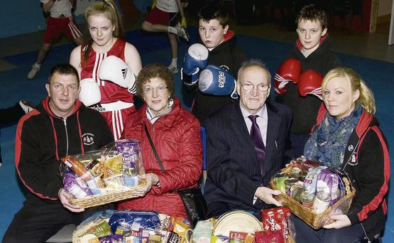 Sliabh Luachra Boxing Club officers, John O'Connell (left) and Samantha O'Sullivan-Coffey (right) making a presentation of hampers to members of the Castleisland branch of the Society of St Vincent de Paul, Helen O'Donoghue and John O'Sullivan at the club on Monday night. The boxers included are Saoirse Kelly, Adam Broderick and Barry O'Connor.