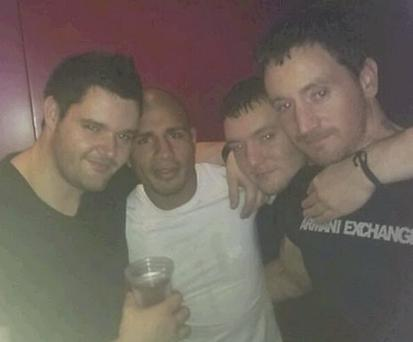 Three division world champion Miguel Cotto with Martin, David and Sean Pembroke at a party after Manny Pacquiao's fight in China.