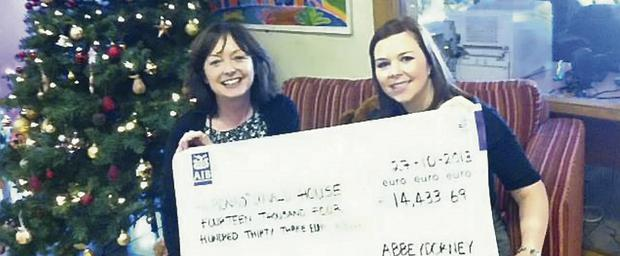 Noelle Jameson, Abbeydorney (right), presents the proceeds of her charity weekend to CEO of the Ronald McDonald House, Marian Carroll.