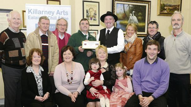 Tony Kenny, Chairman Killarney Arts (back, fourth from left) presenting the Eamon Kelly Bursary 2013 to storyteller Ray O'Sullivan with (front, from left) Mary Murphy, Liz Ryan of Killarney Arts, Kathy, Valerie and Lauren O'Sullivan, John McKenna. (Back, from left) Cllr. Cathal Walshe, Denis Earlie, Killarney Arts; Cllr. Michael Gleeson, Frances and Stephen O'Sullivan of Molly Galvin's, Kenmare, and Tim O'Shea, Killarney Arts, at the Killarney Town Council on Monday.