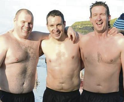 Derek Nagle, Jamie Flynn and Kevin McMahon (best fundraiser on the day) at the Christmas swim in Ballybunion.