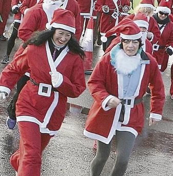 Elaine Kennedy and Veronica Houlihan taking part in the Santa 5km Fun Run (Top) Aoife McKenna, Ellen Greaney, Ellen Sheehy and Caoimhe Collins.