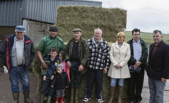 Hay from the UK arriving in Lispole in April to help Kerry farmers. From left: John O'Sullivan, Denis Galvin, Cathal Galvin, Aoibhinn Galvin, Danlaith Galvin, Denis G Galvin, John O'Donnaghae, Celia O'Donnaghae, James Macarthy, IFA, and Sean Brosnan, IFA County Chairman.