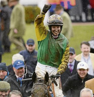Bryan Cooper celebrates aboard Ted Veale after winning the Vincent O'Brien County Handicap Hurdle at the Cheltenham Racing Festival 2013.