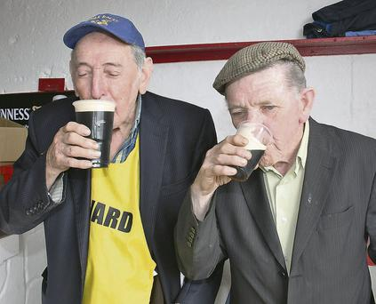 Stevie (left) and Timmy Kelliher, enjoying a pint at last year's Dingle Races.