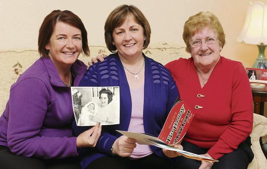 Freda Purcell, Laune View, Killorglin (centre) celebrating her 50 birthday with her sister Sheila and mother Bridie with a copy of the photo which was published in The Kerryman 50 years ago.