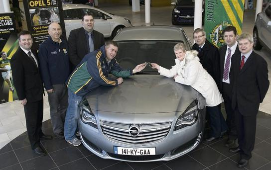Draw winner, Avril Duggan, Gneeveguilla receiving the keys of her new Opel Insignia from Kerry GAA Board Chairman, Patrick O'Sullivan at Ahern's Opel and BMW Dealership in Castleisland. Included are, from left: Paul Ahern, Ahern's; Peter Twiss, Kerry County Board secretary; Patrick Burke, Ahern's; Mrs Duggan's husband Martin; Pat Ahern, Ahern's and Dermot Lynch, Kerry County Board treasurer.