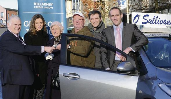 Pat Delaney, Chairman Killarney Credit Union (left) presenting the winner of the Killarney Credit Union member's draw Pat Joe Sweeney with the keys of the Mazda car with Verniece O'Sullivan of O'Sullivan Motors, Mazda Dealer Killarney, Stephen Darmody and Mark Murphy, Manager Killarney Credit Union at the Killarney Credit Union. (Photo by Michelle Cooper Galvin)