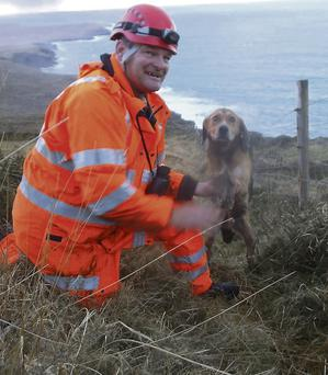Pet beagle Shandon with one of the rescuers.