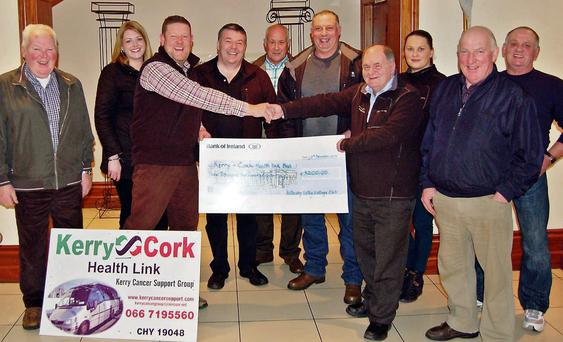 Tom Leslie of the Killarney Valley Vintage Club presenting the proceeds of their Christmas Sponsored Walk to Sean Prendergast Kerry/Cork Health Link Bus with (from left) John Wickham, Suzanne Keane, Padraig Buckley, Thomas Wharton, Tony Wharton, Laura Wickham, Mick Myers and Liam Wharton at the Travel Inn, Fossa.