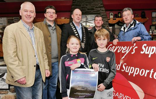 Fionnán Ó hÓgáin (Údaras na Gaeltachta), Jim Garvey (Garvey's SuperValu), Kerry Mayor Seamus Cosaí Fitzgerald, Jerry O'Sullivan (Dingle Brewery) and Colm Bambury with Beth and Kieran Bambury launching the 2014 Dingle Walking Festival in Danno's.